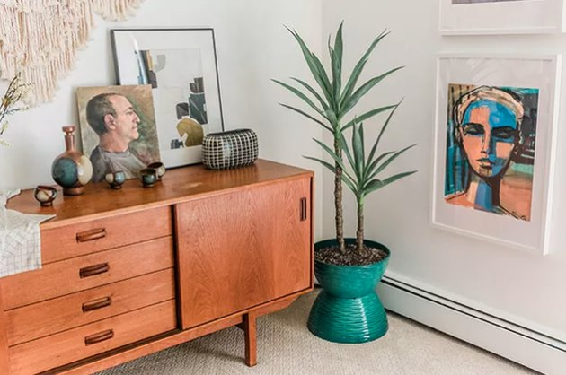Green mod planter with plant in midcentury design