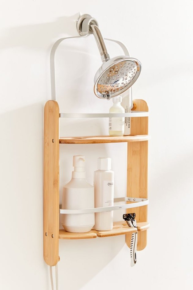 Wood and metal best shower caddes, shower head, shampoos and soaps.