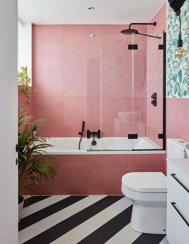 modern bathroom with pink tiles and black and white floors