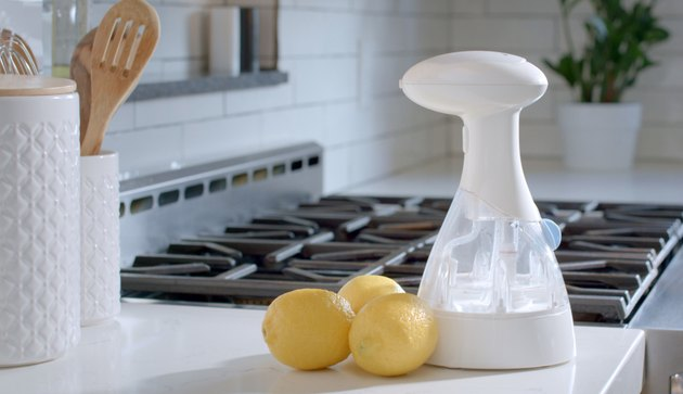 o3waterworks sanitizing spray bottle with lemons on kitchen counter
