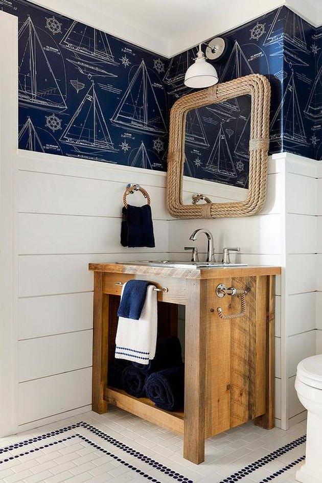 Bathroom with stainless steel bathroom sink by RLH Studio