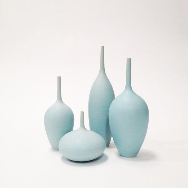 four blue vases