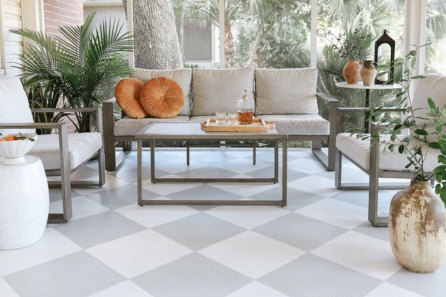 DIY painted gray and white checkerboard floor in sunroom