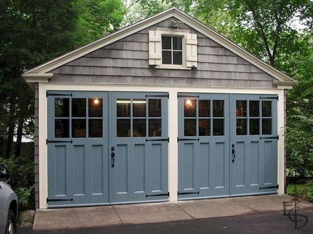 gray garage with blue carriage style garage doors