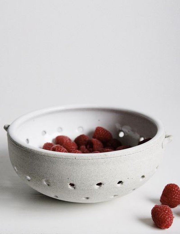 berries in stoneware white collander