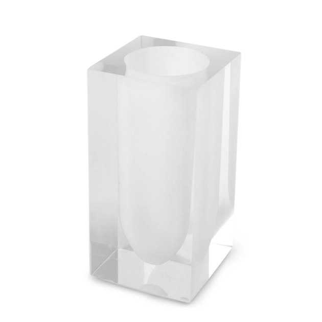 Clear acrylic toothbrush holder on white background