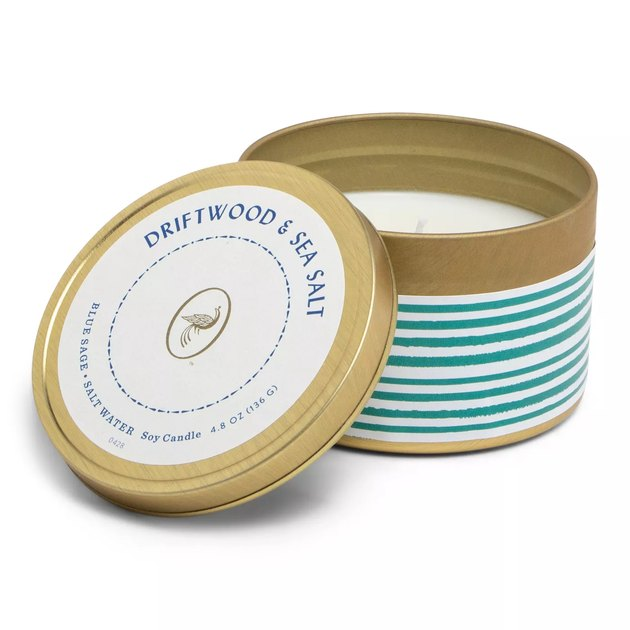 candle in gold tin with striped design