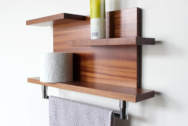 Wood midcentury towel rack for small bathroom and wall shelf with toiletries