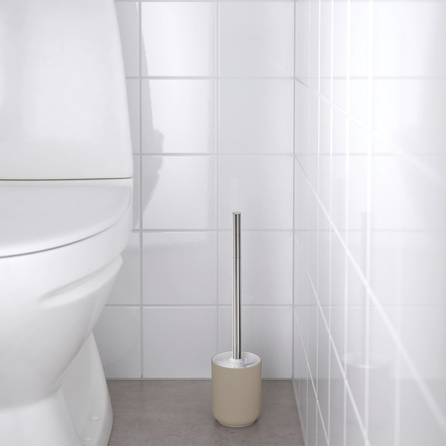 toilet brush near toilet