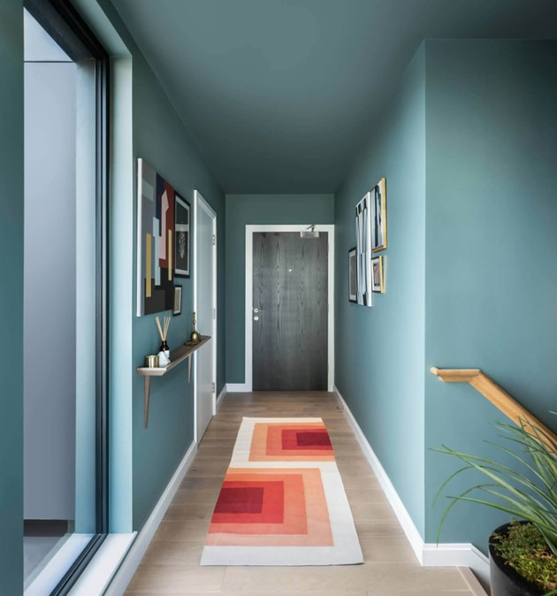 Teal Modern Hallway with orange geometric runner.