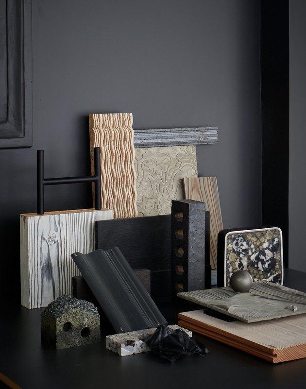 room with decor near inky, dark walls
