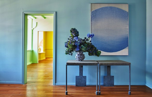 blue room with flowers and painting