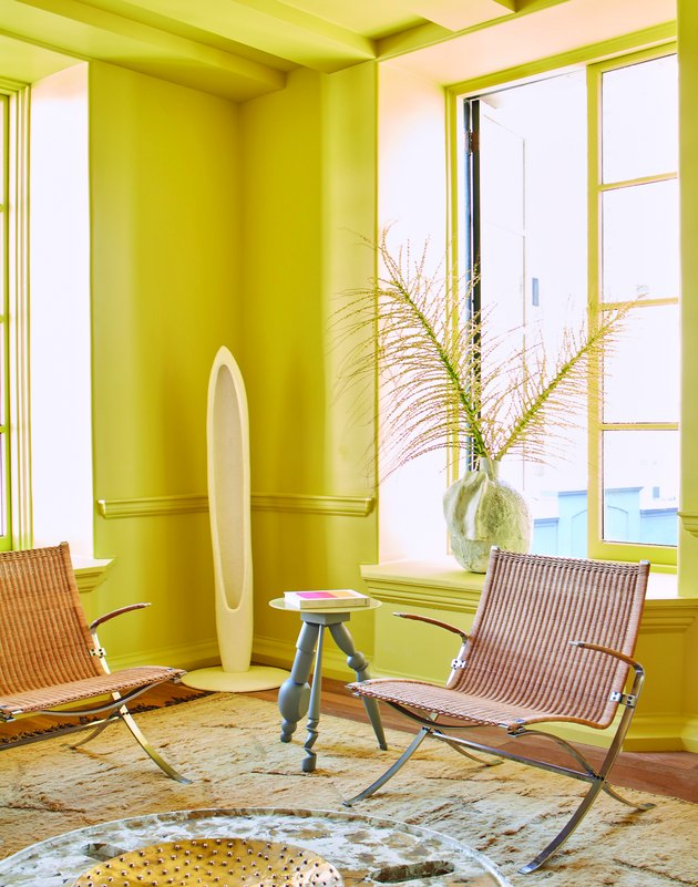 room with chairs and window painted in yellow