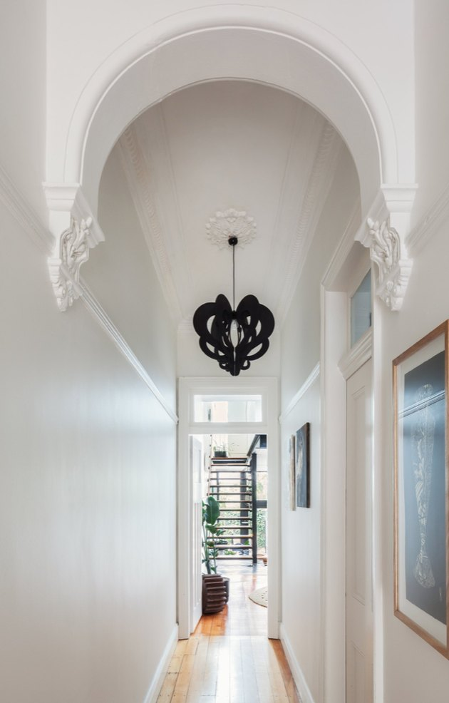 White Modern Hallway with black pendant lamp.