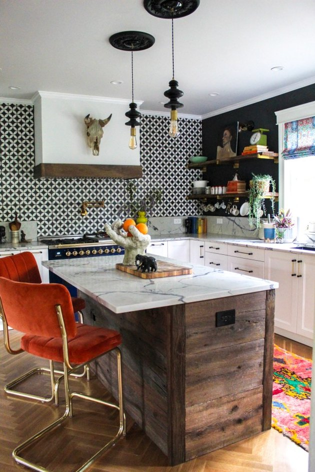 black geometric pendant lights in vintage kitchen above wood island