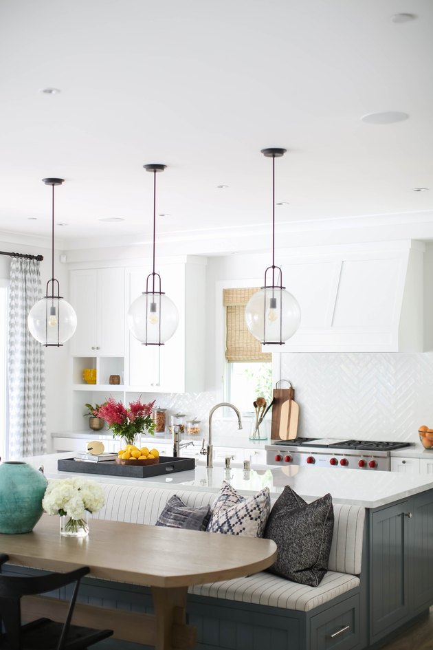 glass globe style lights with black streamlined details in white kitchen