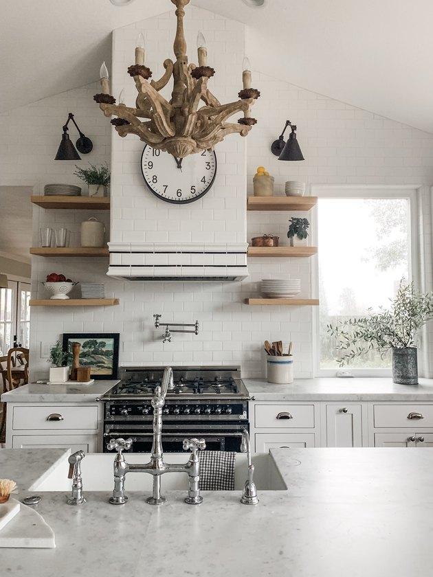 wood chandelier in white modern farmhouse kitchen