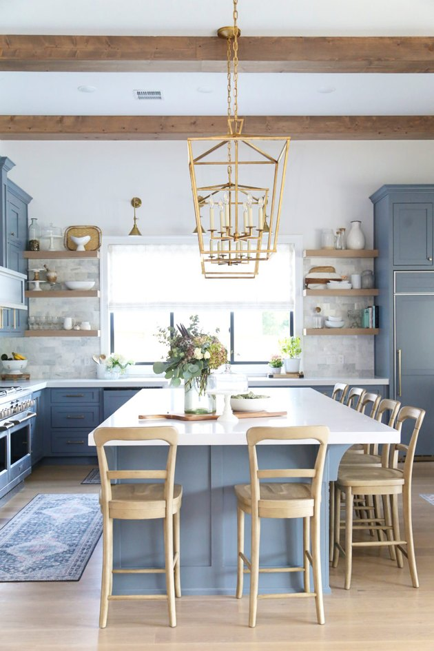large brass lanterns above blue and white island