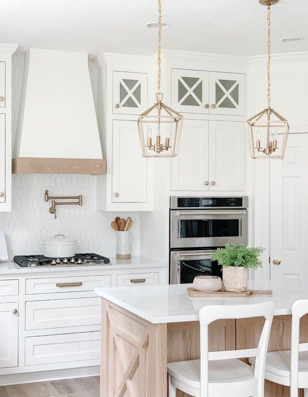 brass vintage style lanterns in white kitchen above island