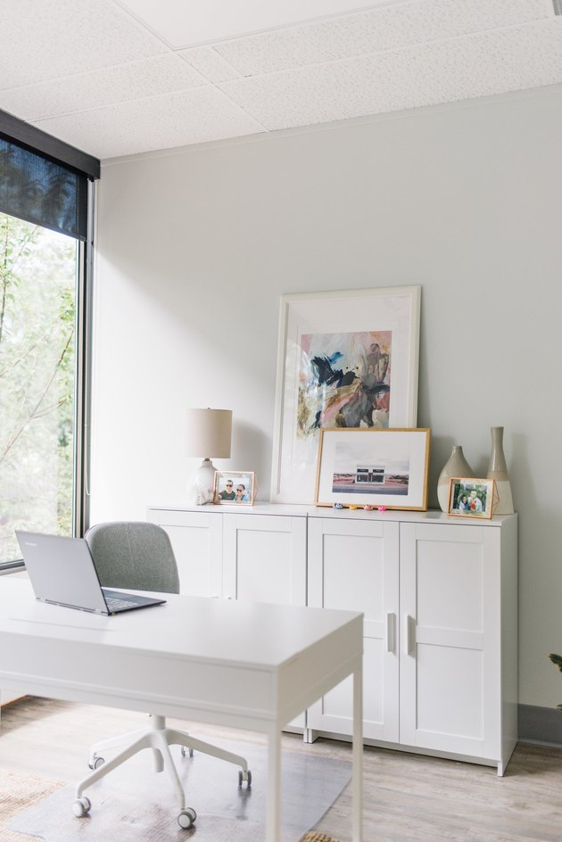 light gray office with white cabinets and white desk