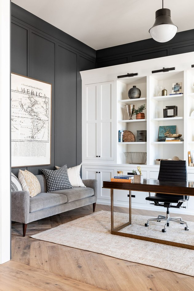 dark gray and white office with white built-ins and modern light fixture