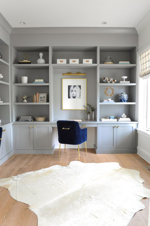 gray home office with built-ins and blue velvet desk chair