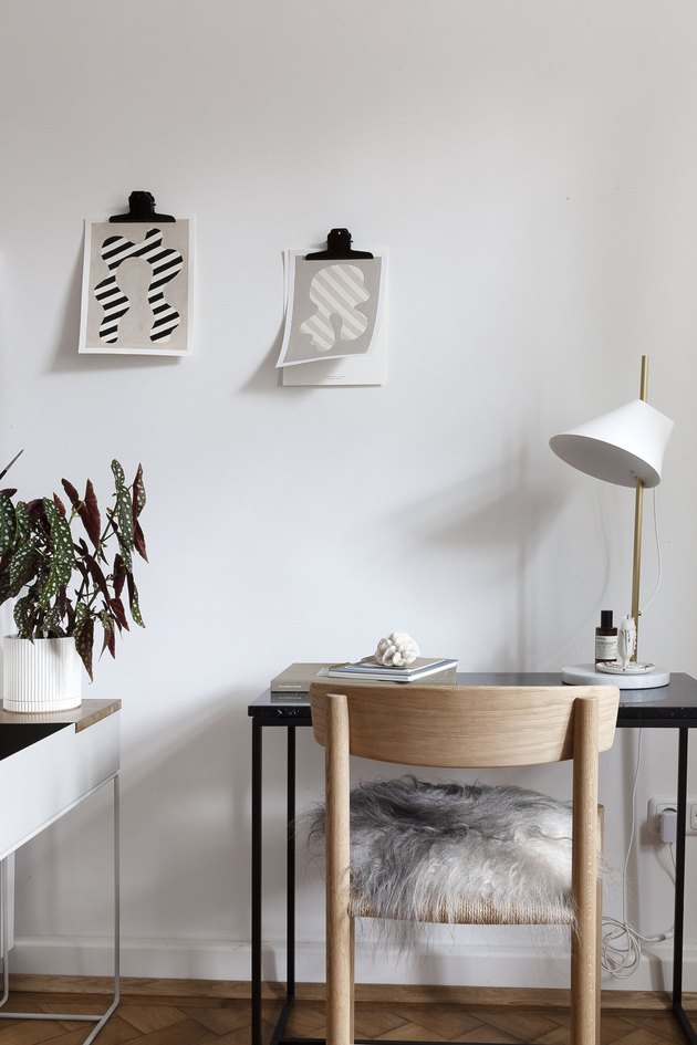 minimalist gray office with simple wall art and wood chair