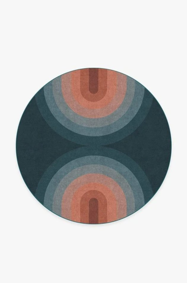 retro rainbow print in red and blue on round rug