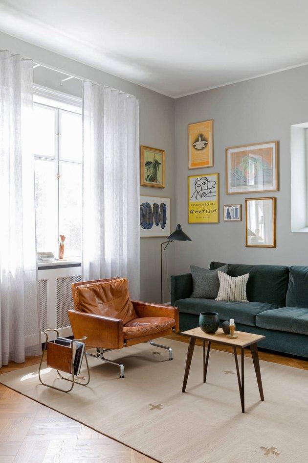 cream and tan Scandinavian area rug with crosses in midcentury room