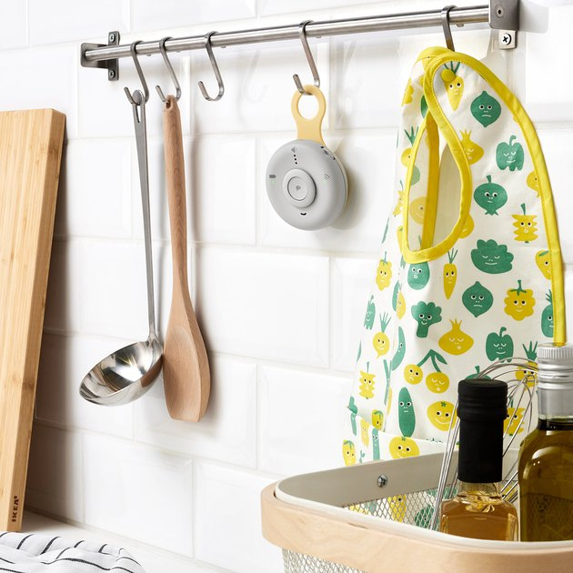 baby monitor hanging from hook in kitchen