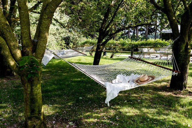 two crochet hammocks suspended on large trees