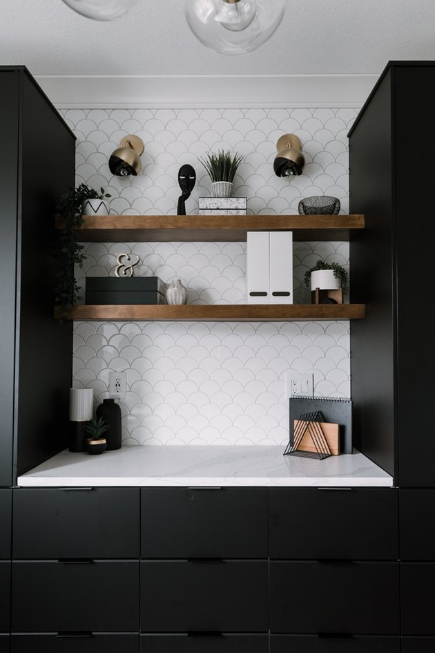black and brass contemporary wall sconces in black and white office
