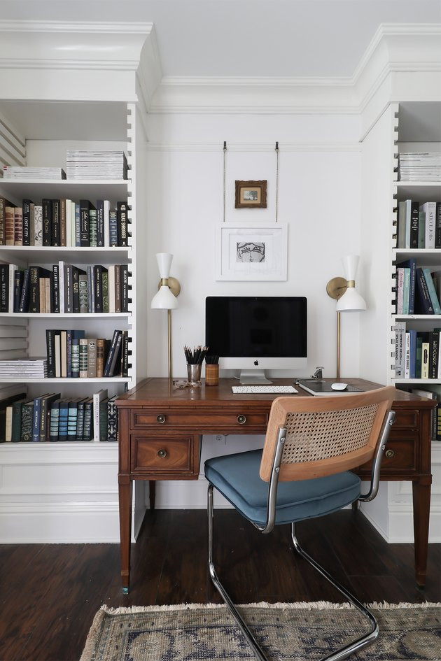 white and brass modern wall sconces in vintage inspired office