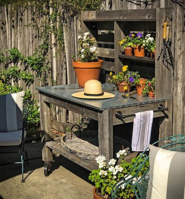 rustic potting table on casters with countertop and shelving