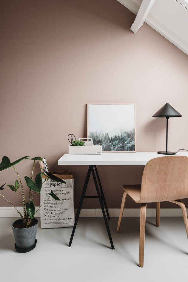 Scandinavian style home office with sleek white desk and blush walls
