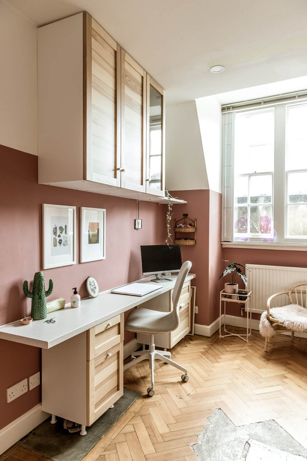 modern home office with pink colorblock walls and light wood furniture