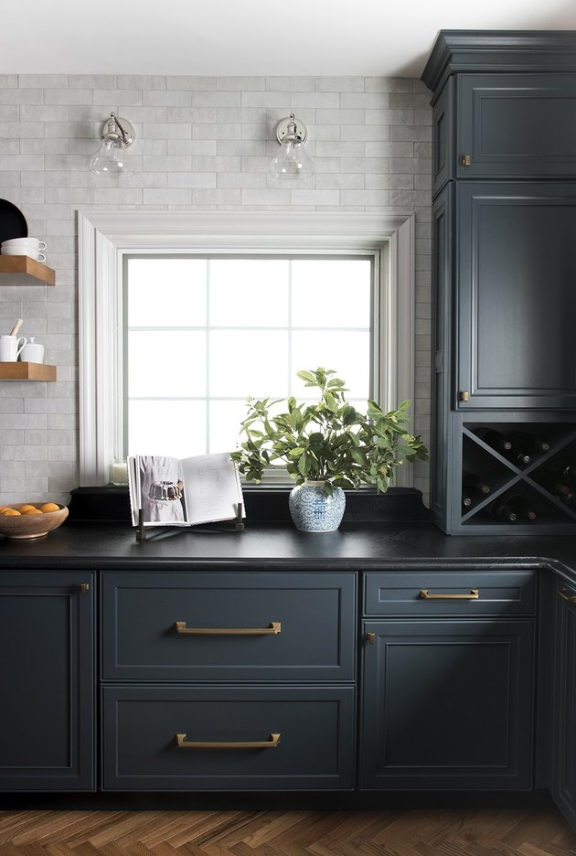 dark blue kitchen cabinets with black soapstone countertop