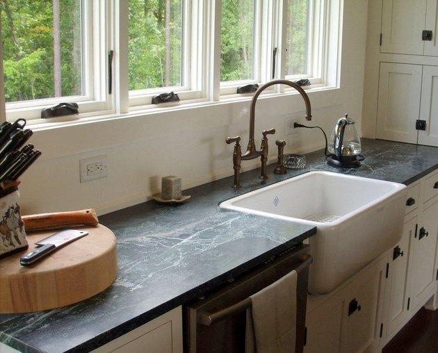 gray soapstone countertops and farmhouse sink with gooseneck bridge faucet