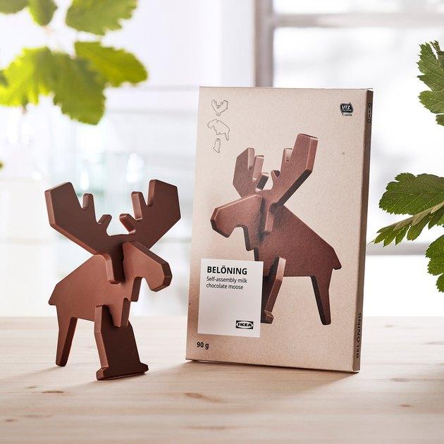 ikea Belöning milk chocolate moose next to packaging on wood table