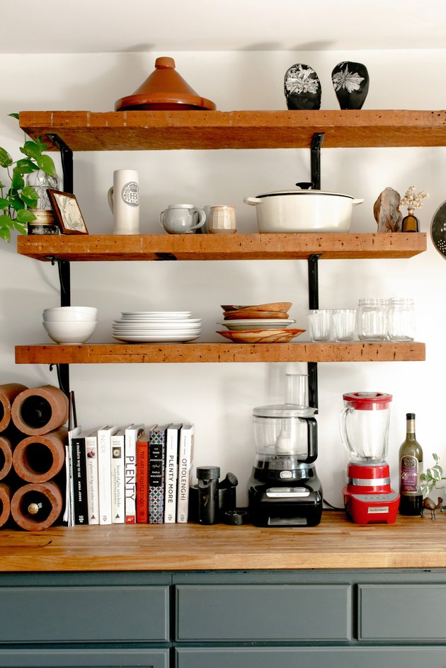 Butcher-Block countertop in kitchen with matching shelfs above the countertops