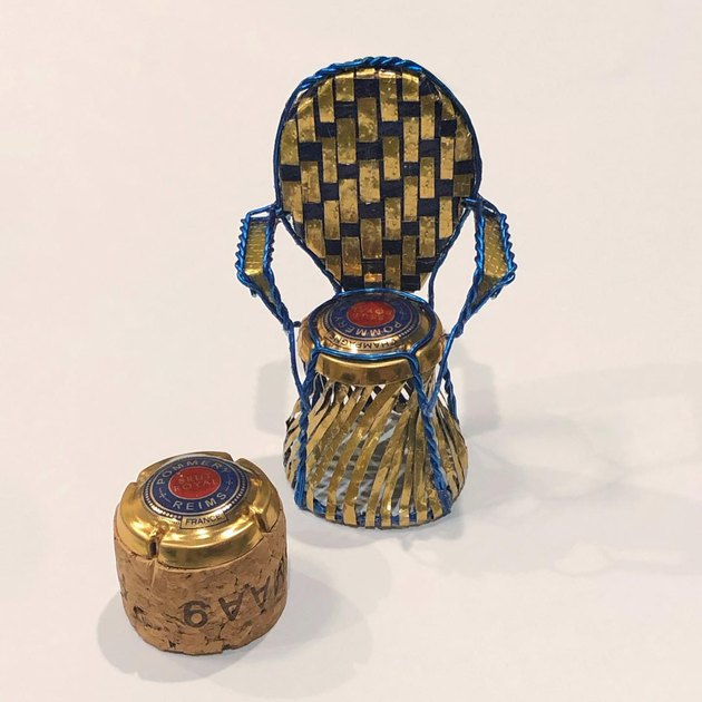 chair and stool made of cork and wine bottle pieces