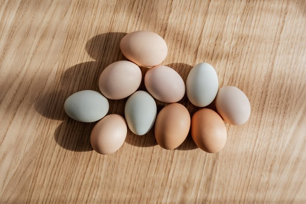 multicolored eggs on light wood surface
