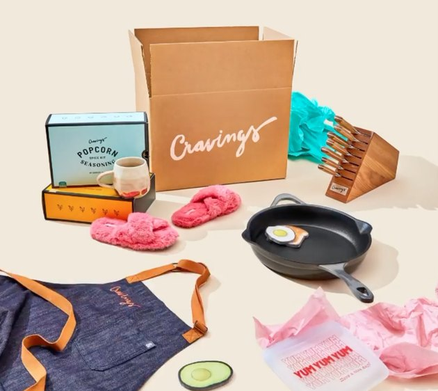 cravings by chrissy teigen box, spice kits, apron, frying pan, knives, slippers, and reusable bag