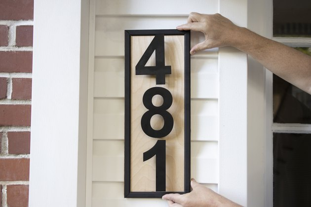 Hanging DIY modern wood address plaque to porch wall
