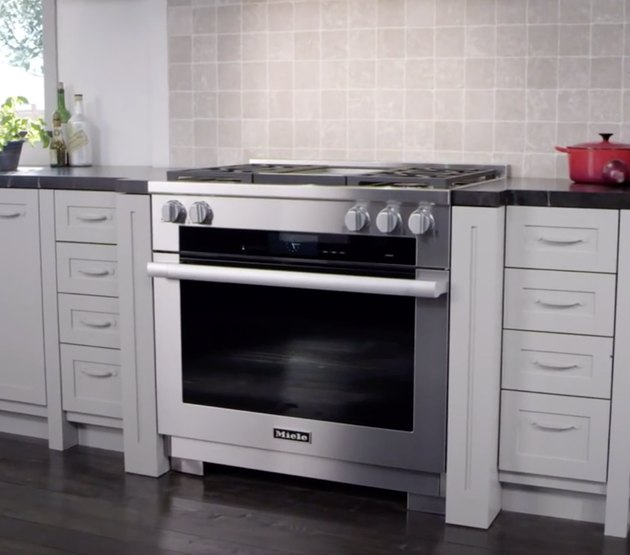 Stainless Steel Gas Stove in kitchen with red dutch oven