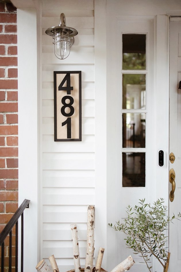 DIY modern house numbers hung underneath industrial style porch light