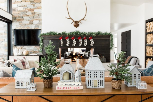 contemporary Christmas decor on sofa table in contemporary living room