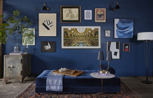 color meaning in eclectic blue dining room with gallery wall