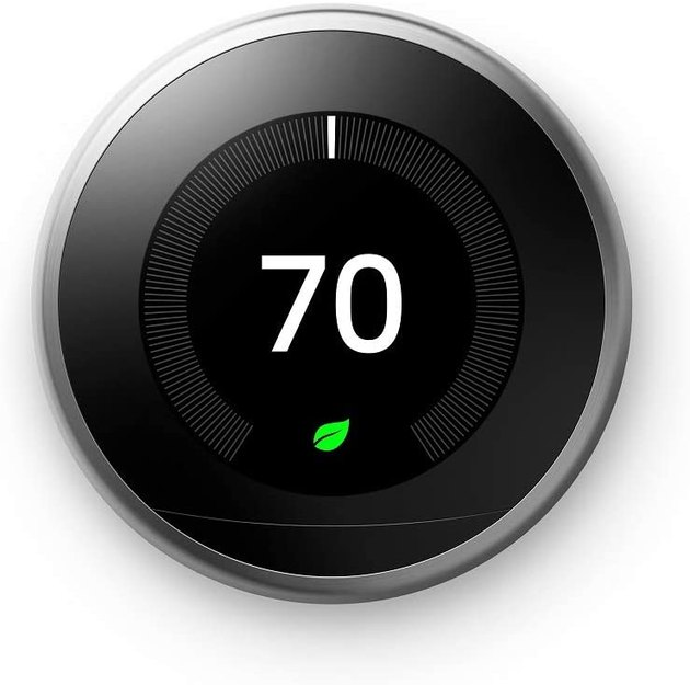 Black round thermostat with touchscreen