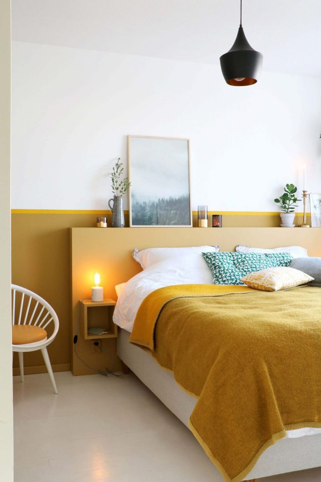 contemporary colors in bedroom with pops of mustard yellow